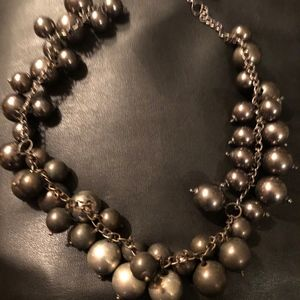 Unusual silver and bronze beaded necklace
